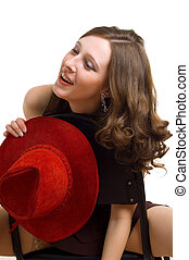 girl with a red hat on a chair