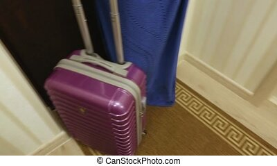 red suitcase leaves the room, the concept of tourism,...