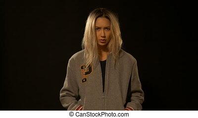 Girl with a serious look posing in studio - Beautiful girl...