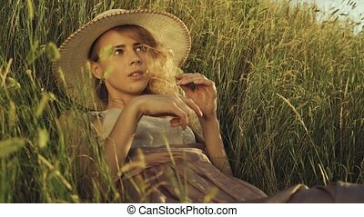 Girl with a spike in her hands lies in the grass - Girl in a...
