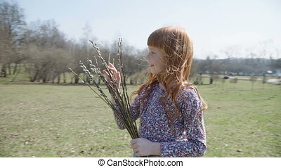 girl with a spring bunch - Cute ginger girl in the park with...