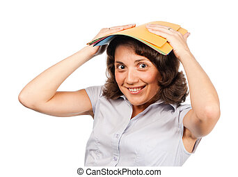 Girl with a stack of paper folders on her head