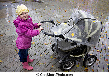 Girl with a stroller.