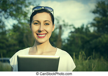Girl with a tablet PC