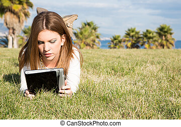 Girl with a tablet - Student girl consulting online with a ...