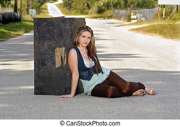 Girl with a Trunk in the Street