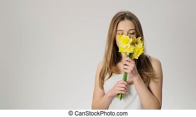 Girl with allergetical reaction smells flowers slow motion -...