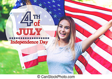GIrl with an American flag on the fourth of July