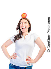 Girl with an apple on her head looking to the side