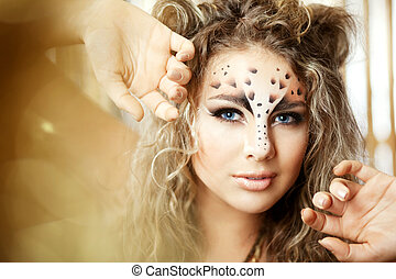 Girl with an unusual make-up as a leopard - The image of a ...