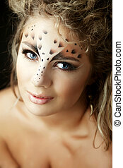 Girl with an unusual make-up as a leopard
