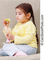 Girl with apple slice