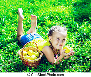 girl with apples - happy girl eating apples in the park