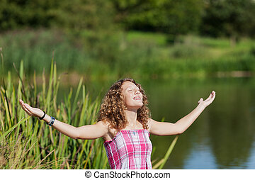Girl With Arms Outstretched At Park