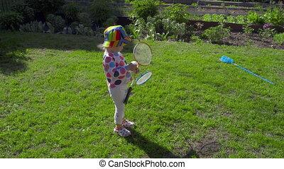 Girl with badminton rackets