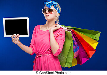girl with bags and tablet in hand