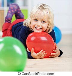 Girl With Balloons Lying On Floor