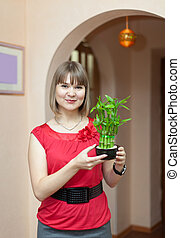 Girl with  bamboo plant