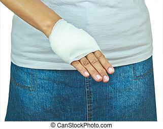 girl with bandage hand