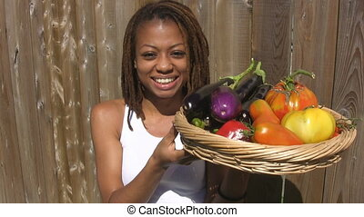 Girl with basket of vegetables.