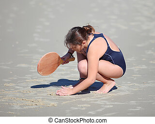 girl with beach rackets - small girl playing with beach...