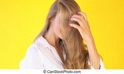 girl with beautiful hair wind yellow