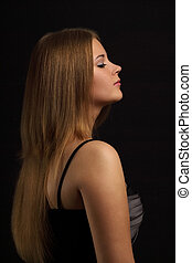 Girl with beauty long hair on black background