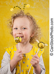 Girl with bee cake pops