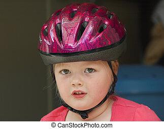 girl with bicycle helmet