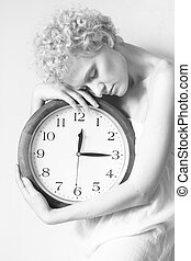 Girl with big clock in hands, b/w photo.