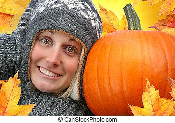 Girl with big pumpkin
