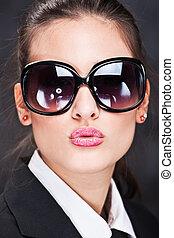 girl with big sun glasses sending kiss