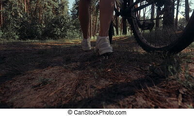 Girl with bike in the Woods