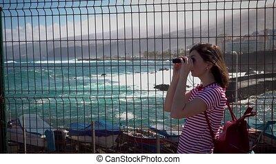 girl with binoculars looking toward forbidden zone - girl...