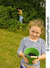 girl with blackberries