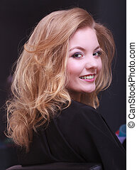 Girl with blond wavy hair in salon