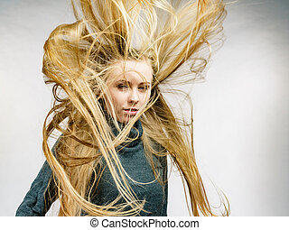 Girl with blowing long hair