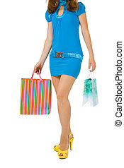 girl with blue dress with packages