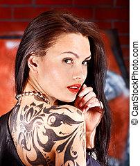Girl with body art. - Woman with body art aganist graffiti...