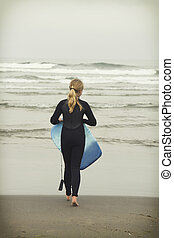 Girl with body board on Rockaway beach Oregon