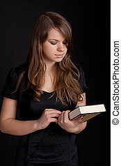 Girl with book in hand