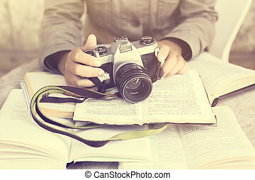 Girl with books and old camera, vintage photo effect