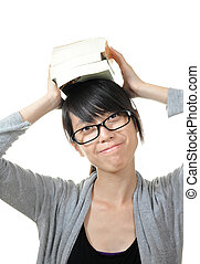 girl with books on head