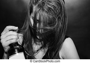 Girl with bottle of alcohol