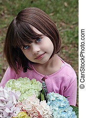 Girl with bouquet - Beautiful little girl witha bunch of...