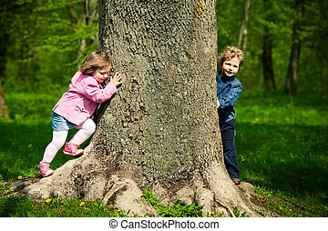 girl with boy playing hide and seek