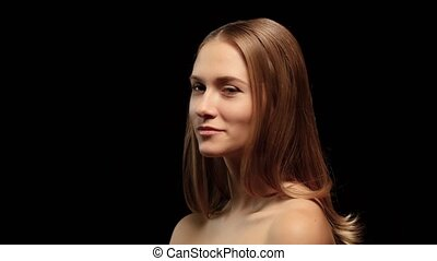 Girl with braces and a beautiful hair color turns to the camera and laughs. Black