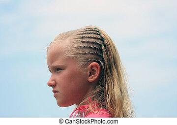 Girl With Braids on a Beach