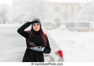 Girl with Brush and Shovel Removing Snow from the Car