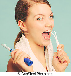 Girl with brush and tongue cleaner.
